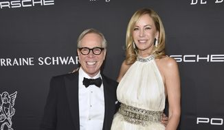 Tommy Hilfiger, left, and Dee Ocleppo attend the Angel Ball benefitting Gabrielle's Angel Foundation for Cancer Research at Cipriani Wall Street on Monday, Nov. 21, 2016, in New York. (Photo by Evan Agostini/Invision/AP)