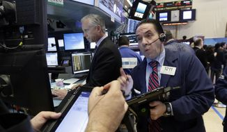 Trader Tommy Kalikas, right, works on the floor of the New York Stock Exchange, Monday, Nov. 21, 2016. U.S. stocks are rising in early trading as the price of oil jumps and energy companies move higher, keeping indexes at record highs. (AP Photo/Richard Drew)