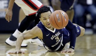 Georgia's Juwan Parker, back, and George Washington's Jair Bolden (3) chase the ball during the first half of an NCAA college basketball game Monday, Nov. 21, 2016, in Kansas City, Mo. (AP Photo/Charlie Riedel) **FILE**