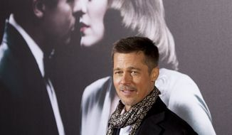 "U.S. actor Brad Pitt poses for photographers during a photocall for the premiere of his new film ""Allied"" in Madrid, Spain, on Tuesday Nov. 22, 2016. (AP Photo/Abraham Caro Marin)"