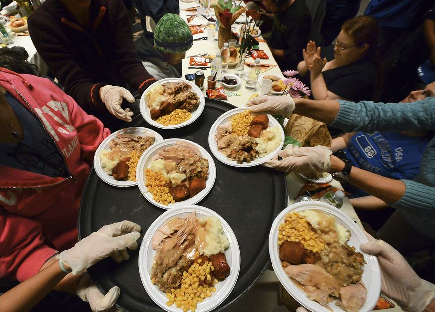 Plates of hot turkey dinners with all the trimmings are for Thanksgiving dinner with all the trimmings