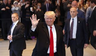 President-elect Donald Trump waves to the crowd as he leaves the New York Times building following a meeting, Tuesday, Nov. 22, 2016, in New York. (AP Photo/Mark Lennihan)