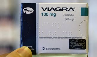 In this April 9, 2008, file photo, a package of Viagra is pictured in Hamburg, Germany. (AP Photo/Fabian Bimmer, File) **FILE**