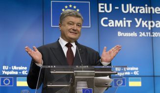 Ukrainian President Petro Poroshenko speaks during a media conference at the conclusion of an EU-Ukraine summit at the European Council building in Brussels on Thursday, Nov. 24, 2016. (AP Photo/Virginia Mayo)