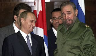 FILE - In this Thursday, Dec. 14, 2000, file photo, Russian President Vladimir Putin, left, and Cuban President Fidel Castro talk before signing agreements in Havana, Cuba. Castro, who led an improbable rebel victory, embraced Soviet-style communism long after the collapse of the Soviet Union and defied the power of 10 U.S. presidents, died at age 90, Friday, Nov. 25, 2016. (AP Photo/Alexander Zemlianichenko, File)
