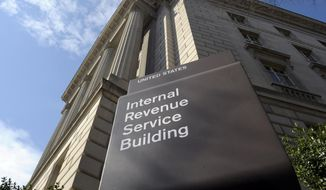 This photo March 22, 2013, file photo shows the exterior of the Internal Revenue Service (IRS) building in Washington. (AP Photo/Susan Walsh, File)