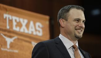 Tom Herman talks to the media during a news conference where he was introduced as Texas' new head football coach, Sunday, Nov. 27, 2016, in Austin. (AP Photo/Eric Gay)