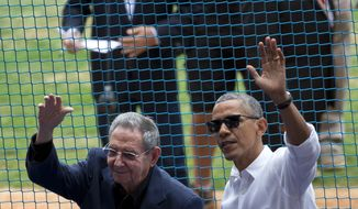 FILE - This March 22, 2016 file photo shows U.S. President Barack Obama, right, and his Cuban counterpart Raul Castro wave to cheering fans as they arrive for a baseball game between the Tampa Bay Rays and the Cuban national baseball team, in Havana, Cuba. Castros passing removes what was long the single greatest psychological barrier to a warmer U.S.-Cuban relationship. But it also adds to the uncertainty ahead with the transition from an Obama to Trump administration. (AP Photo/Rebecca Blackwell, File)