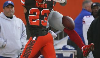 Cleveland Browns cornerback Joe Haden (23) breaks up a pass intended for New York Giants wide receiver Odell Beckham (13) in the first half of an NFL football game, Sunday, Nov. 27, 2016, in Cleveland. (AP Photo/Ron Schwane)