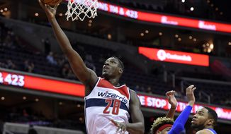 Washington Wizards center Ian Mahinmi (28), of France, goes to the basket during the second half of an NBA preseason basketball game against the Philadelphia 76ers, Thursday, Oct. 13, 2016, in Washington. The Wizards won 100-79. (AP Photo/Nick Wass) **FILE**