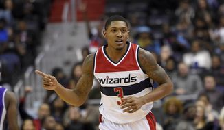 Washington Wizards guard Bradley Beal (3) gestures after he hit a basket during the first half of an NBA basketball game against the Sacramento Kings, Monday, Nov. 28, 2016, in Washington. (AP Photo/Nick Wass)