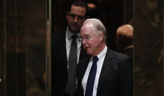 Elevators close on Rep. Tom Price, R-Ga., as he arrives at Trump Tower, Wednesday, Nov. 16, 2016, in New York. (AP Photo/Carolyn Kaster)