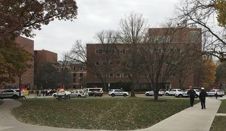 Police respond to reports of an active shooter on campus at Ohio State University on Monday, Nov. 28, 2016, in Columbus, Ohio. (AP Photo/Andrew Welsh-Huggins)