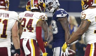 Washington Redskins cornerback Josh Norman (24) and Dallas Cowboys wide receiver Dez Bryant (88) have an exchange during an NFL football game, Thursday, Nov. 24, 2016, in Arlington, Texas. (AP Photo/Michael Ainsworth)