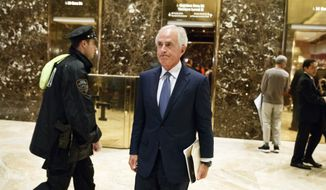 Sen. Bob Corker, R-Tenn., walks to talk with reporters in the lobby of Trump Tower after a meeting with President-elect Donald Trump, Tuesday, Nov. 29, 2016, in New York. (AP Photo/Evan Vucci) ** FILE **