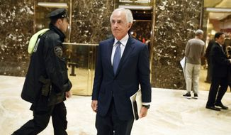 Sen. Bob Corker, R-Tenn., walks to talk with reporters in the lobby of Trump Tower after a meeting with President-elect Donald Trump, Tuesday, Nov. 29, 2016, in New York. (AP Photo/Evan Vucci)