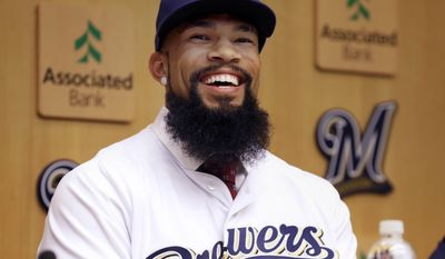 Eric Thames smiles during a Milwaukee Brewers introductory press conference in Milwaukee, Wisc., Tuesday, Nov. 29, 2016. The Brewers signed free agent Eric Thames, who spent the last three seasons in Korea, and designated slugging first baseman Chris Carter for assignment on Tuesday. (Rick Wood/Milwaukee Journal-Sentinel via AP)