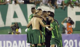 In this Wednesday, Nov. 23, 2016, file photo, players of Brazil's Chapecoense celebrate at the end of a Copa Sudamericana semifinal soccer match against Argentina's San Lorenzo in Chapeco, Brazil. A chartered aircraft with 81 people on board, including the Brazilian first division Chapecoense soccer team heading to Colombia for a regional tournament final, has crashed on its way to Medellin's international airport. (AP Photo/Andre Penner, File)