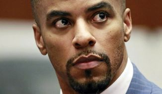FILE - In this March 23, 2015, file photo, former NFL football player Darren Sharper appears in Los Angeles Superior Court. The former NFL star case reaches its conclusion Tuesday, Nov. 29, 2016, in the courthouse where he first admitted drugging and raping women in four states. The sentencing in Los Angeles Superior Court marks the end of prosecutions that unmasked the popular former all-pro safety and Super Bowl champ as a serial rapist. (AP Photo/Nick Ut, Pool, File)