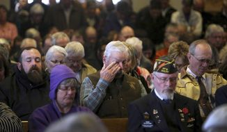 Mourners pack the Oregon Trail State Veterans Cemetery in Evansville, Wyo., on Tuesday morning, Nov. 29, 2016, for the funeral of Vietnam veteran Stephen Carl Reiman. Reiman died alone on Nov. 17 after traveling to Casper, Wyo., from Southern California for unknown reasons. Reiman had been homeless and suffering from PTSD. (Dan Cepeda/Casper Star-Tribune via AP)