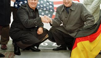 FILE - In this Oct. 1, 1998 file photo, Elvis Presley's former road manager and friend Joe Esposito, left, shakes hands with Bremerhaven mayor Manfred Richter at the point Elvis stepped on German soil. The King of Rock n Roll came to Germany by ship as a soldier of the US Army.  Esposito's daughter Cindy Bahr said Tuesday, Nov. 29, 2016, that he had dementia and died Nov. 23 of natural causes in Calabasas, Calif. He was 78. (AP Photo/Joerg Sarbach, File)