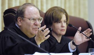 FILE - In this Feb. 27, 2008 file photo, Missouri Supreme Court Judge Richard B. Teitelman asks a question of attorneys as they present their case in the Missouri Supreme Court in Jefferson City. A court spokesperson said Tuesday, Nov. 29, 2016, that Teitelman has died, but provided no other details. Teitelman had served on the court since March 2002 and was chief justice from July 2011 through June 2013. (Julie Smith/The News-Tribune via AP, File)