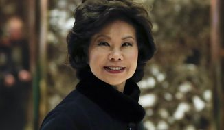 In this Nov. 21, 2016 photo, former Labor Secretary Elaine Chao arrives at Trump Tower in New York, to meet with President-elect Donald Trump.  President-elect Trump has picked Elaine Chao as Transportation secretary. (AP Photo/Carolyn Kaster)