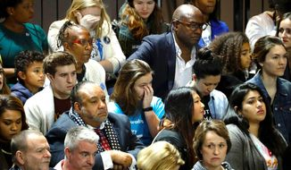 Troubled Democrats watch results during presidential nominee Hillary Clinton's election night rally in the Jacob Javits Center in New York. (Associated Press)