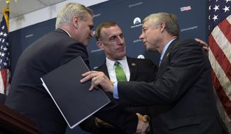 House Majority Leader Kevin McCarthy of Calif., left, shakes hands with Rep. Tim Murphy, R-Pa., center, and Rep. Fred Upton, R-Mich, right, during a news conference on Capitol Hill in Washington, Wednesday, Nov. 30, 2016. Upton and Murphy talked about the 21st Century Cures Act which would provide $6.3 billion over the next decade, including $1 billion for state grants for programs for preventing and treating the abuse of opioids and other addictive drugs. It would also expand government mental health programs. (AP Photo/Susan Walsh)