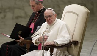 Pope Francis attends his weekly general audience in the Paul VI Hall, at the Vatican, Wednesday, Nov. 30, 2016. During the winter months the general audience is held indoors instead of in St. Peter's Square. (AP Photo/Andrew Medichini)