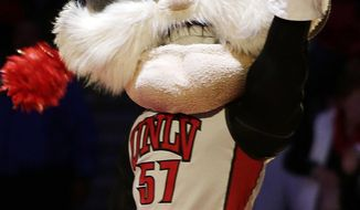 """FILE - In this Feb. 1, 2014, file photo, UNLV mascot Hey Reb! warms up the crowd before an NCAA college basketball game in Las Vegas. The student newspaper at the University of Nevada, Las Vegas, is changing its name from """"Rebel Yell"""" to """"The Scarlet & Gray Free Press"""" in a bid to end criticism that it evokes the Civil War Confederacy, officials said. The move comes after several months of debate and a year after a campus diversity office report commissioned by university President Len Jessup concluded that neither the campus """"Rebels"""" nickname nor its """"Hey Reb!"""" mascot have ties to the Confederacy. (AP Photo/Isaac Brekken, File)"""
