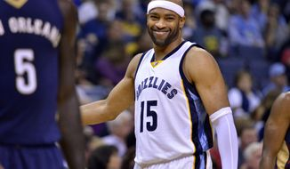 FILE - In this Nov. 2, 2016, file photo, Memphis Grizzlies guard Vince Carter (15) reacts in the first half of an NBA basketball game against New Orleans, in Memphis, Tenn. Carter is no longer the NBA's highest flyer, though he's certainly not ready to be grounded. (AP Photo/Brandon Dill, File)