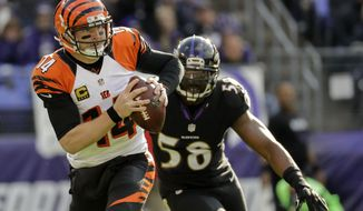 FILE - In this Nov. 27, 2016, file photo, Cincinnati Bengals quarterback Andy Dalton (14) scrambles out of the reach of Baltimore Ravens outside linebacker Elvis Dumervil (58) during the first half of an NFL football game in Baltimore. Back in action at long last, Elvis Dumervil hopes to put a rousing finish on a frustrating season in which he's missed eight games while recovering from foot surgery. (AP Photo/Patrick Semansky, File)