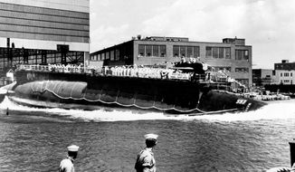 "FILE - In this July 9, 1960 file photo the 278-foot (82 meters) long nuclear powered attack submarine USS Thresher, a first in its class boat, is launched bow-first at the Portsmouth Navy Yard in Kittery, Maine. A Navy submarine that left a Connecticut base this week is carrying the ashes of a veteran to be buried at sea near the site of the USS Thresher's sinking. For half a century Navy Capt. Paul ""Bud"" Rogers struggled with feelings that it should have been him and not his last-minute replacement on the doomed voyage. (AP Photo, File)"