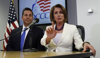 House Minority Leader Nancy Pelosi of Calif., joined by Democratic Congressional Campaign Committee Chairman, Rep. Ben Ray Lujan, D-N.M., speaks during an election day news conference at the Democratic Congressional Campaign Committee Headquarters in Washington, In this Nov. 8, 2016, file photo. (AP Photo/Carolyn Kaster)