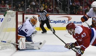 New York Islanders goalie Jaroslav Halak (41), of Czech Republic, makes a save on a shot from Washington Capitals right wing Tom Wilson (43) during the second period of an NHL hockey game, Thursday, Dec. 1, 2016, in Washington. (AP Photo/Molly Riley)