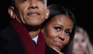 President Barack Obama and first lady Michelle Obama watch the musical performances at the 2016 National Christmas Tree lighting ceremony at the Ellipse near the White House in Washington, Thursday, Dec. 1, 2016. (AP Photo/Pablo Martinez Monsivais)