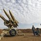 FILE - In this Nov. 13, 2012 file photo obtained from the Iranian Mehr News Agency, Iranian army members prepare missiles to be launched, during a maneuver, in an undisclosed location in Iran. President Barack Obama may have to decide this year whether to use military force to fulfill his vow to prevent Iran from being able to build nuclear weapons, foreign policy experts say. But America's economic and military realities argue intensely against attacking the Islamic Republic and for muddling through by, perhaps, further tightening sanctions that have cut deeply into Tehran's economy. (AP Photo/Mehr News Agency, Majid Asgaripour, File)