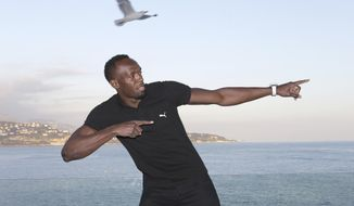 """Jamaican sprinter Usain Bolt who is nominated for the International Athletic Foundation """"2016 Athlete of the Year Award"""", gestures before a press conference, Friday, Dec. 2, 2016, in Monaco. The IAAF 2016 World Athletics Gala will take place tonight in Monaco. (AP Photo/Claude Paris)"""