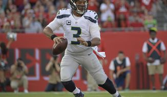 FILE - In this Sunday, Nov. 27, 2016 file photo, Seattle Seahawks quarterback Russell Wilson (3) looks to pass during the first quarter of an NFL football game against the Tampa Bay Buccaneers in Tampa, Fla. For the seventh time in five years, the Panthers and Seahawks will meet on Sunday night, Dec. 4, 2016 each with a different sense of urgency heading into the final month of the regular season. (AP Photo/Phelan Ebenhack, File)