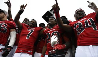 Western Kentucky players cheer after they were presented with Conference USA championship trophy after they defeated Louisiana Tech 58-44 in an NCAA college football game, Saturday, Dec. 3, 2016 at L.T. Smith Stadium in Bowling Green, Ky. (AP Photo/Michael Noble Jr.)
