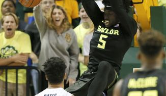 Xavier's Kaiser Gates (22) and Baylor's King McClure (22) watch as forward Johnathan Motley (5) dunks in the first half of an NCAA college basketball game, Saturday, Dec. 3, 2016, in Waco, Texas. (AP Photo/Tony Gutierrez)