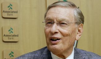 FILE - In this Sept. 26, 2014, file photo, Major League Baseball Commissioner Bud Selig speaks before a baseball game between the Milwaukee Brewers and the Chicago Cubs in Milwaukee. Former commissioner Selig and longtime general manager John Schuerholz have been elected to the baseball Hall of Fame. Schuerholz was picked by all 16 voters Sunday, Dec. 4, 2016, on a veterans committee at the winter meetings. Selig was listed 15 times. (AP Photo/Morry Gash, File)