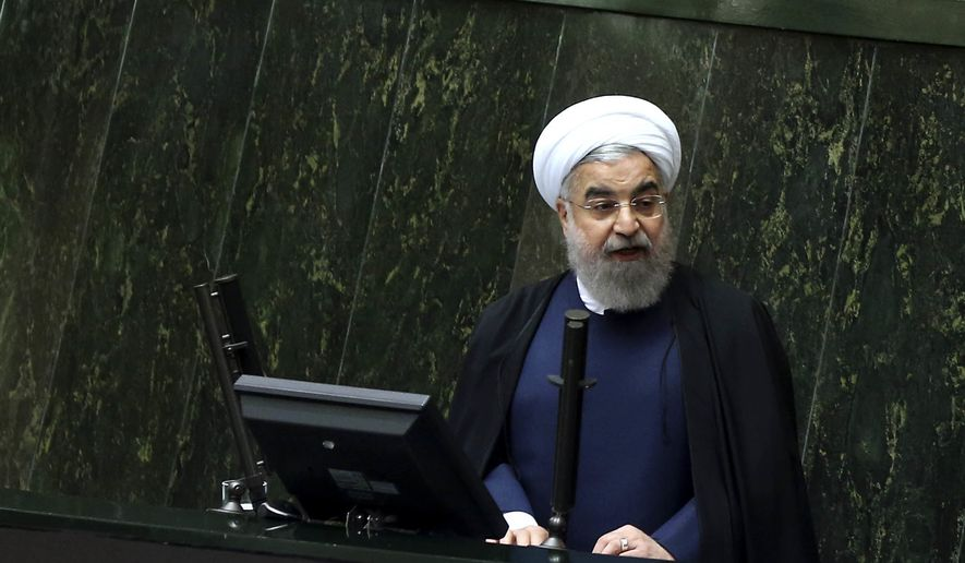 Iranian President Hassan Rouhani speaks while submitting his next year's budget bill in an open session of parliament in Tehran, Iran, Sunday, Dec. 4, 2016. Iran's official IRNA news agency reported that President Hassan Rouhani submitted a $83 billion budget bill to parliament for the next fiscal year, beginning in March. The budget is seven percent more than the current budget in Iranian rials. But it is less in U.S. dollars due to the recent drop in the rial against the dollar. The current year's budget is $97 billion. (AP Photo/Vahid Salemi)