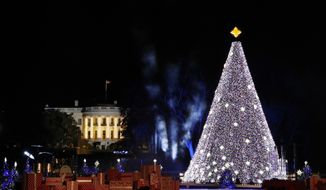 The White House and 2016 National Christmas Tree are seen during the lighting ceremony on the Ellipse, Thursday, Dec. 1, 2016 in Washington. (AP Photo/Alex Brandon)