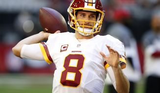 Washington Redskins quarterback Kirk Cousins (8) warms up prior to an NFL football game against the Arizona Cardinals, Sunday, Dec. 4, 2016, in Glendale, Ariz. (AP Photo/Ross D. Franklin)
