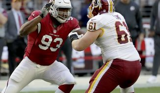Arizona Cardinals defensive end Calais Campbell (93) lines up against Washington Redskins center Spencer Long (61) during the first half of an NFL football game, Sunday, Dec. 4, 2016, in Glendale, Ariz. (AP Photo/Rick Scuteri)