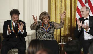 The recipients of the 2016 Kennedy Center Honors, actor Al Pacino and musician James Taylor, applaud gospel and blues singer Mavis Staples as she is recognized, during a reception in their honor in the East Room of the White House in Washington, Sunday, Dec. 4, 2016, hosted by President Barack Obama and first lady Michelle Obama. (AP Photo/Manuel Balce Ceneta)