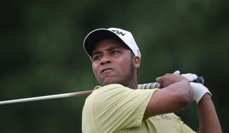 FILE - In this May 2, 2016, file photo, Harold Varner III tees off the 18th hole during the final round of the PGA Zurich Classic golf tournament at TPC Louisiana in Avondale, La. Varner held on to win the Australian PGA Championship in Gold Coast, Australia, on Sunday, Dec.4, 2016 by two shots after a roller-coaster last round of 65 that included seven birdies and two bogeys in an entertaining nine-hole stretch at Royal Pines. (AP Photo/Gerald Herbert, File)