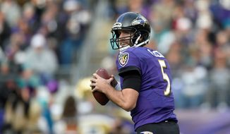 Baltimore Ravens quarterback Joe Flacco completed a franchise-record 36 passes to 11 different receivers Sunday in a 38-6 win over the Miami Dolphins. (Associated Press)